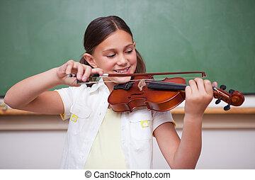 schoolgirl, tocando, a, violino
