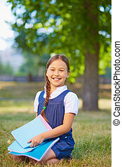 Schoolgirl with copybooks