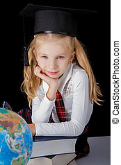 choolgirl with hat and globe sitting on black background