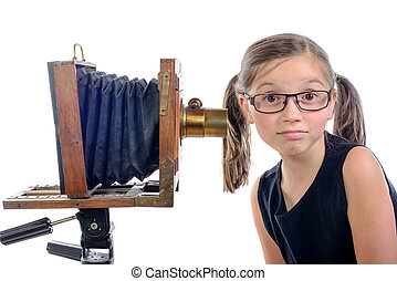 schoolgirl with old camera