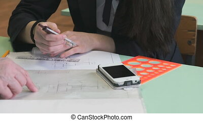 Schoolgirl working with smartphone and calliper - Lesson at...