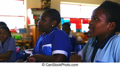 Schoolgirls in a lesson at a township school 4k