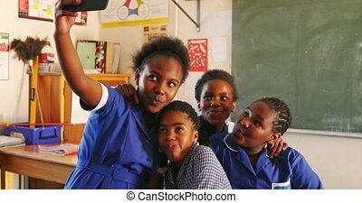 Schoolgirls taking selfies during a break at a township school 4k