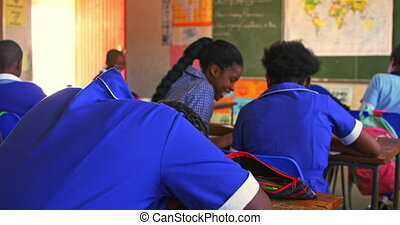 Schoolgirls talking in a lesson at a township school 4k - ...