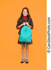 Schooling in style. Happy child hold school backpack yellow background. Book bag of knowledge. September 1. Knowledge day. Back to school. Primary education. Private teaching. Startup
