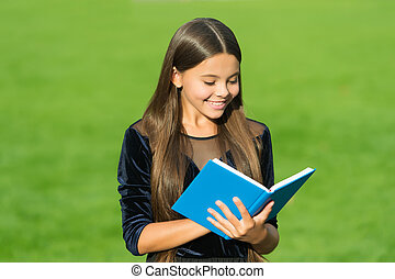 Schooling is foundation for future. Happy child read book green grass. Back to school. September 1. Formal schooling. Knowledge day. Private teaching. Private lesson