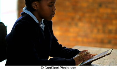 Schoolkid using digital tablet in classroom 4k - Schoolkid ...