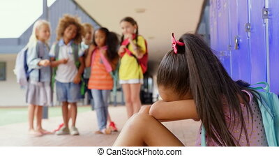 Schoolkids bullying a crying Asian girl in the corridor of elementary school 4k