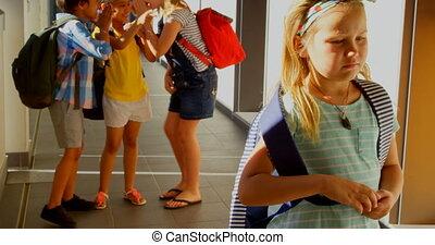 Schoolkids bullying a sad girl in hallway of elementary ...