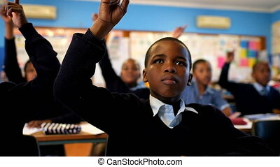 Schoolkids hand raised in the classroom 4k - Schoolkids hand...