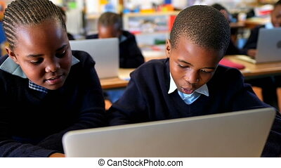 Schoolkids using laptop in classroom 4k - Schoolkids using ...