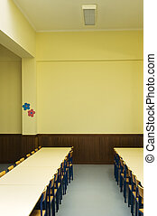 Schoolroom interior with chairs and tables