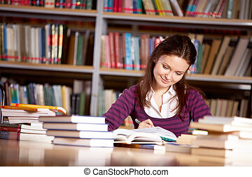 Schoolwork - Portrait of charming student getting ready for...