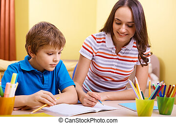 Schoolwork with mother - Portrait of cute schoolboy and his ...