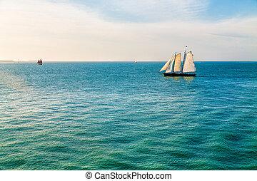 Schooner on Aqua Water - Schooner under sails sailing across...