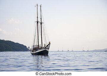 Schooner - A two-mast schooner with sails down near Praslin...