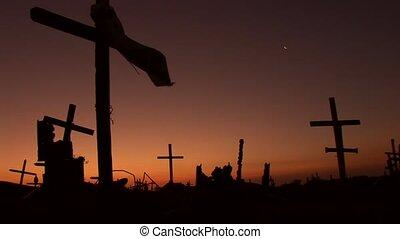 schrikaanjagend, ondergaande zon , cementery