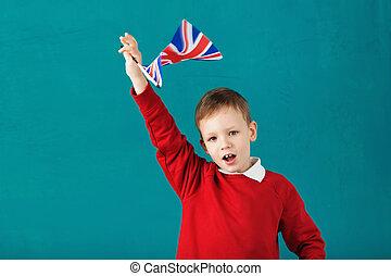 schulferien, vereinigtes königreich, (uk)., wenig, schuljunge, mit, nationales kennzeichen, von, der, vereint, kingdom.