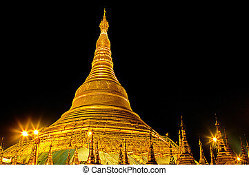 Gold encrusted spire of the Shwedagon Paya (Pagoda), rebuilt in the 18th century, in the city of Yangon- Burma (Myanmar)