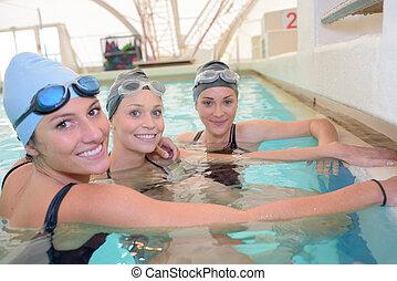 schwimmender, posierend, mannschaft