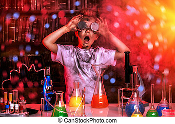science - A boy doing experiments in the laboratory. ...