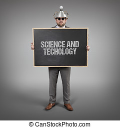 science and techology text on blackboard with businessman -...