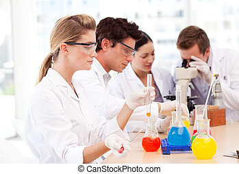 Science students in a laboratory - Young science students in...