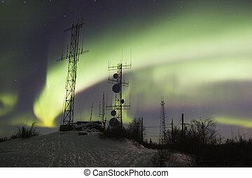 Scientific antennas under northern lights
