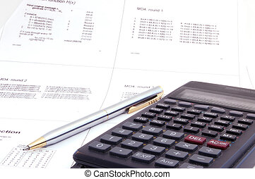scientific calculator and pen on the lecture note -...