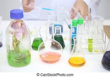 Scientific laboratory glassware filled with color liquid