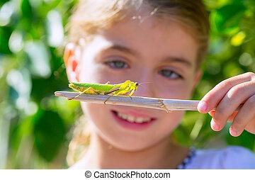 naturalist biologist kid girl looking praying mantis -...