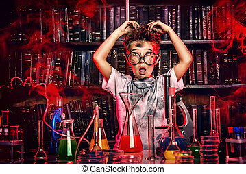scientist - A boy doing experiments in the laboratory. ...