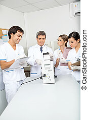 Scientist Analyzing Sample In Medical Laboratory