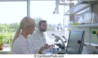 Scientist and students working in lab. Doctor teaching ...