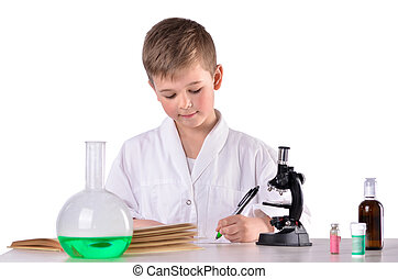 Scientist boy in the chemistry lab write with a pen