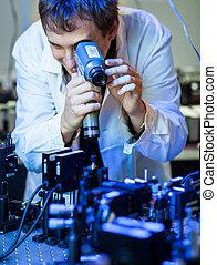 scientist doing research in a quantum optics lab (shallow...