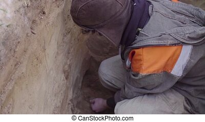 Scientist getting samples of soil - Scientist ecologist...