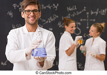 Scientist holding a laboratory glassware
