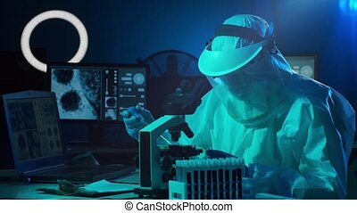 Scientist in protection suit and masks working in research ...