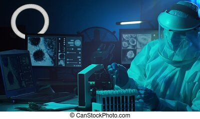 Scientist in protection suits and masks working in research ...