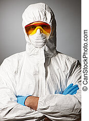 Scientist in protective wear, glasses and respirator
