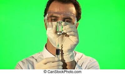Scientist injecting blue liquid