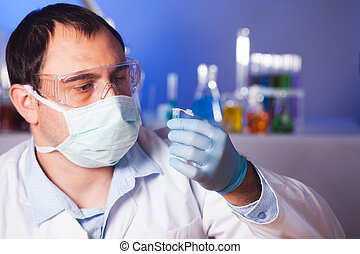 Scientist is thinking about research and hold eppendorf tube
