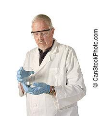 Scientist looking into petri dish