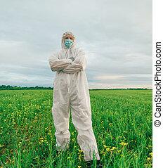 Scientist man standing on summer field