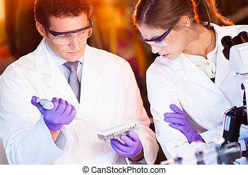 Scientist pipetting.