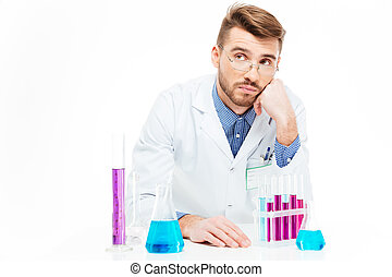 Scientist pouring chemicals