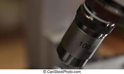 Scientist Studying Specimen With Microscope.
