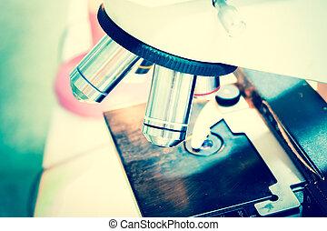 Scientist using microscope in a laboratory