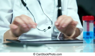 Scientist using Touch Pad - Doctor Woman Using Digital...